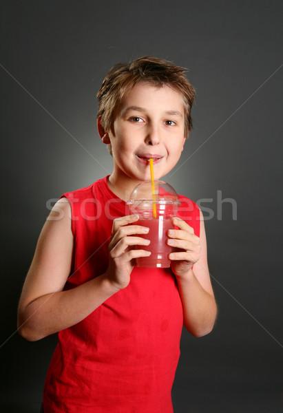 Child drinking fresh berry fruit juice Stock photo © lovleah