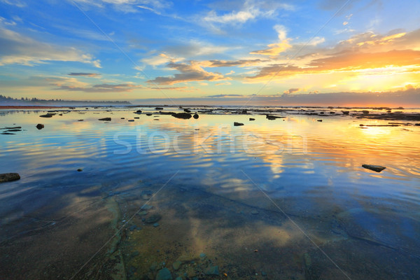 Stock photo: Heaven and Earth reflecting.  Morning sky reflected in the ocean
