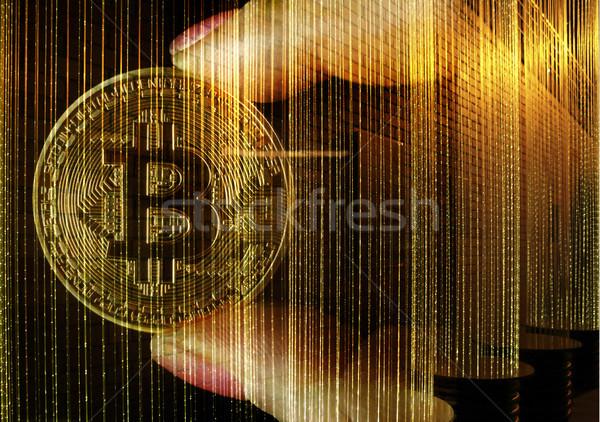 Hands holding a golden Bitcoin Stock photo © lovleah