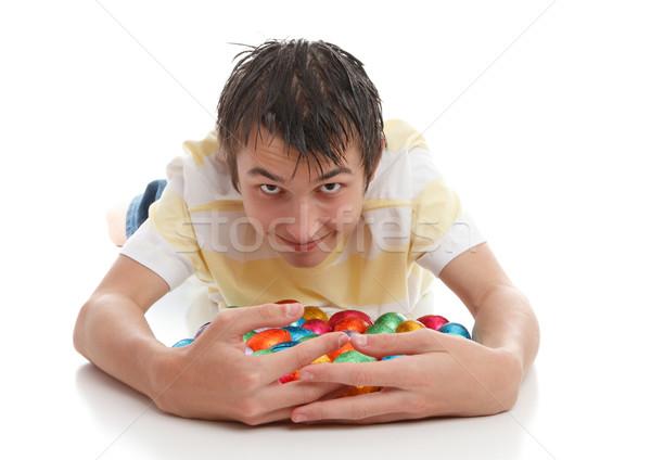 Boy hoarding easter eggs Stock photo © lovleah