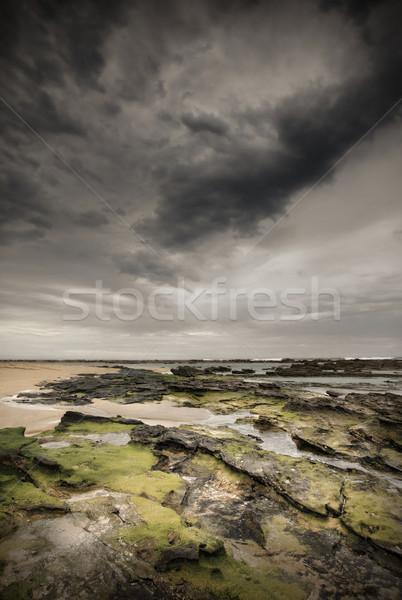 Viharfelhők kicsi nehéz moha fedett kövek Stock fotó © lovleah