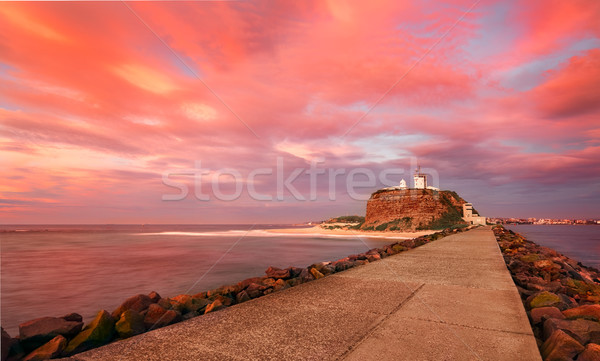 Red sunrise at Nobby's Lighthouse Australia Stock photo © lovleah