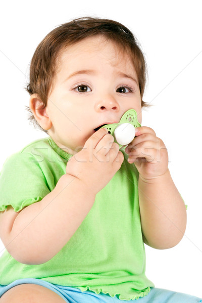 Baby putting a dummy into mouth Stock photo © lovleah