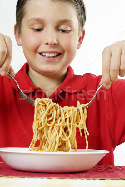 Child tossing pasta noodles Stock photo © lovleah