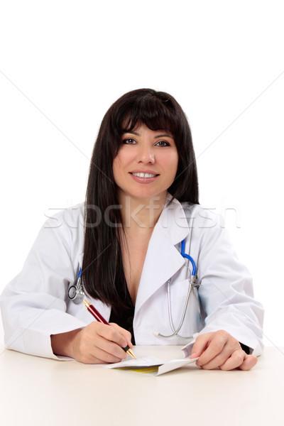 Doctor writing  prescription Stock photo © lovleah