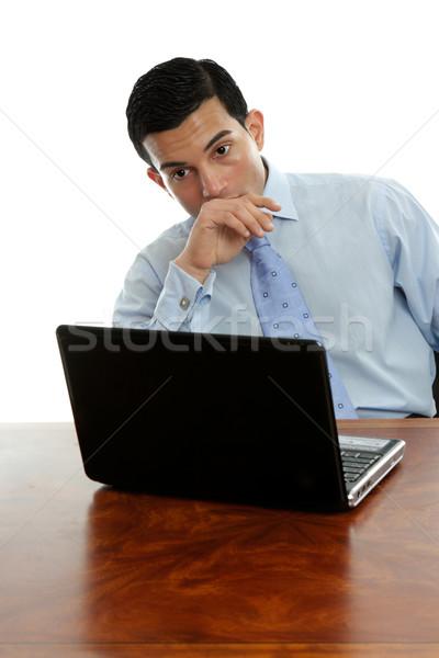 Man sitting at desk thinking pondering Stock photo © lovleah