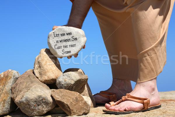 Man holding rock with bible verse John 8:7 Stock photo © lovleah