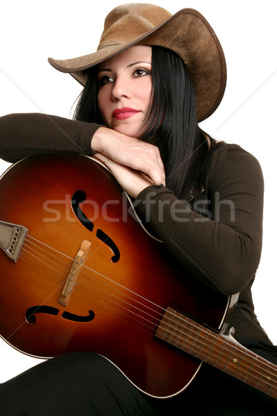 Country female performer and guitar Stock photo © lovleah