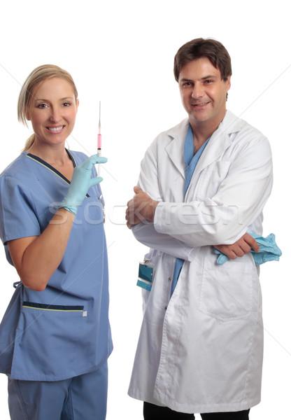 Surgeon and scrub nurse Stock photo © lovleah