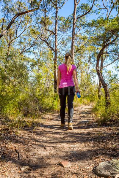 Female walking along a bush track among nature Stock photo © lovleah