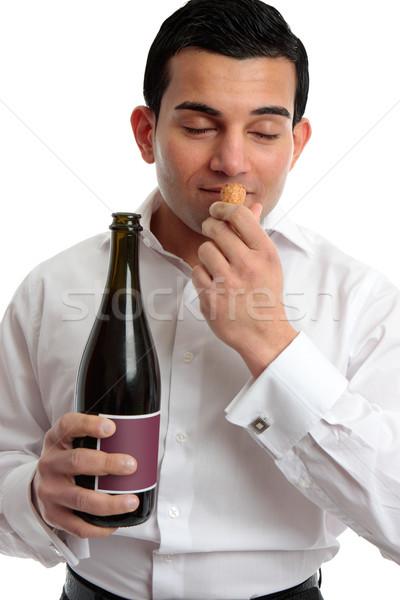 Man sniffing wine cork Stock photo © lovleah
