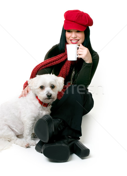 Woman relaxing with a small pet dog Stock photo © lovleah