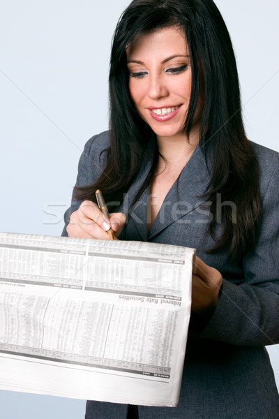 Smiling businesswoman finance newspaper Stock photo © lovleah