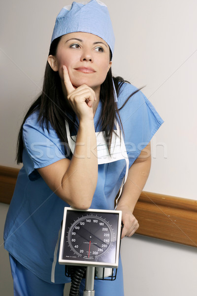 Female hospital worker in corridor Stock photo © lovleah