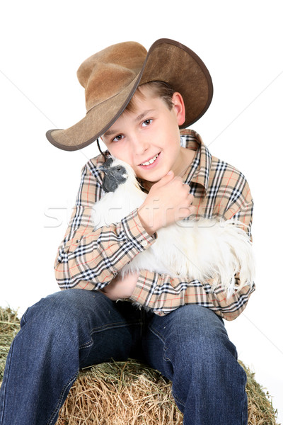 Farm boy holding a chicken Stock photo © lovleah