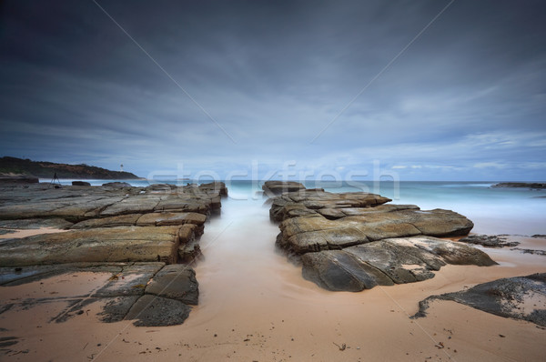 Stormy beach with natural rock channel Soldiers Beach point Stock photo © lovleah