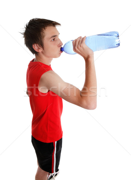 Teenager drinking bottled water Stock photo © lovleah
