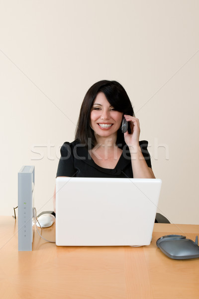 Woman at work.  Wireless networking and voip Stock photo © lovleah