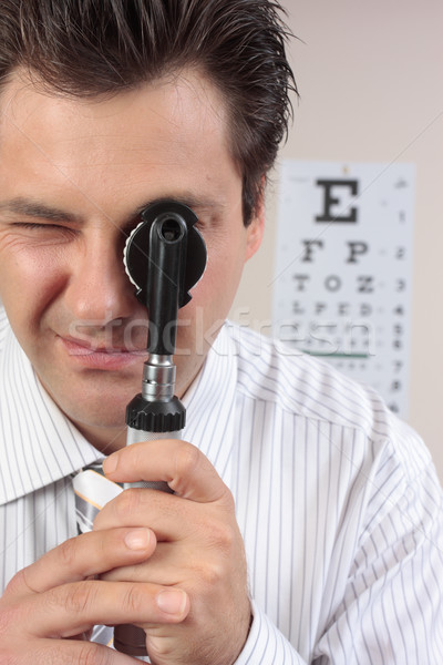 Eye doctor using opthalmoscope Stock photo © lovleah