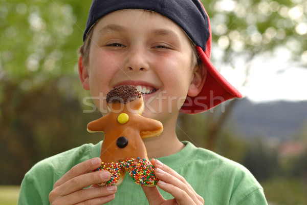 Grinning  boy with a doughnut Stock photo © lovleah
