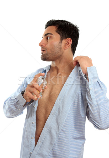 Man spraying perfume cologne Stock photo © lovleah