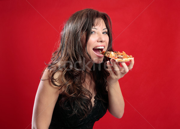 Happy woman eating pizza Stock photo © lovleah