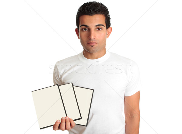 Stock photo: Man holding set DVD movies or games in his hand