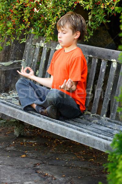 Zen meditatie jongen vergadering kruis yoga Stockfoto © lovleah