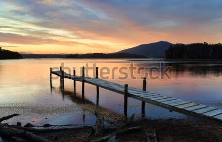 Park bank zeegezicht zonsopgang Stockfoto © lovleah