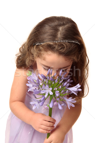 Young girl sniffing flower Stock photo © lovleah