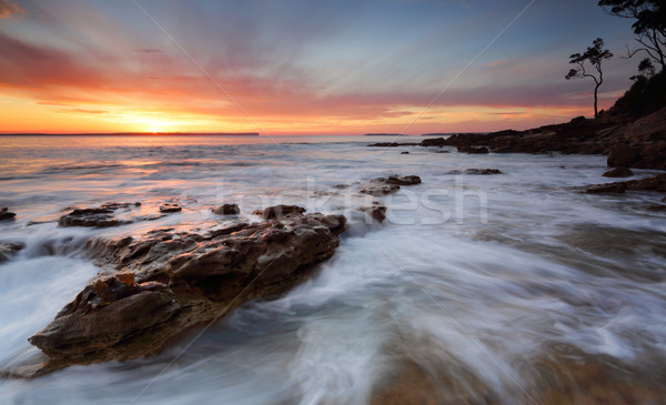 Sunrise over the Bay with ocean over rocks Stock photo © lovleah