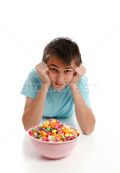 Boy relaxes with bowl of snack food Stock photo © lovleah