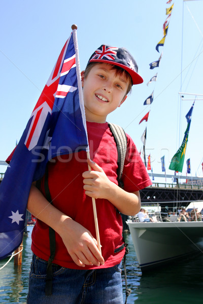Aussie boy with flag harbourside Stock photo © lovleah