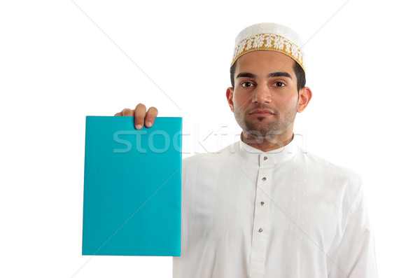 Ethnic businessman with brochure or advertisement Stock photo © lovleah