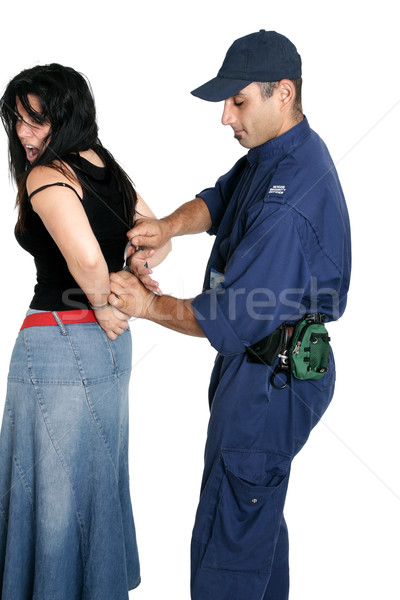 Suspect thief being handcuffed Stock photo © lovleah