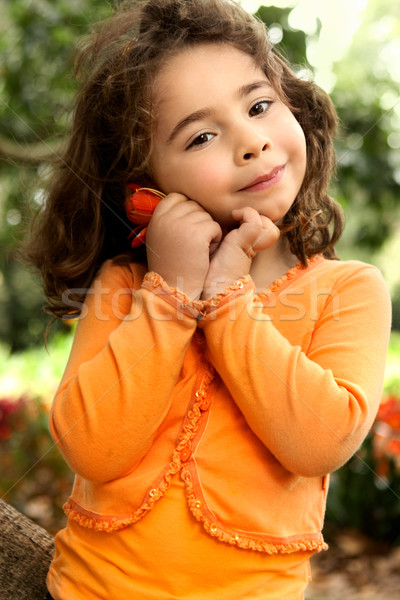 Beautiful little girl holding a flower picked from the garden Stock photo © lovleah