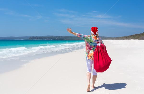 Christmas in Australia - festive woman walking along idyllic bea Stock photo © lovleah