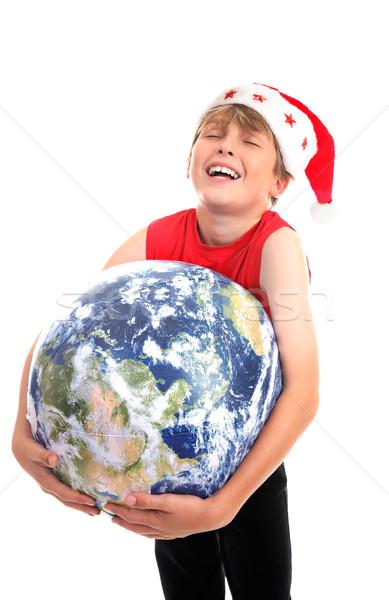 Christmas boy hugging planet earth Stock photo © lovleah