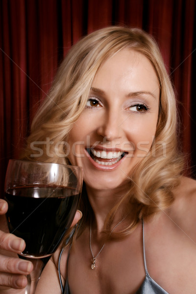 Happy woman drinking red wine Stock photo © lovleah