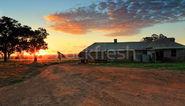 Farm buildings at sunset Stock photo © lovleah