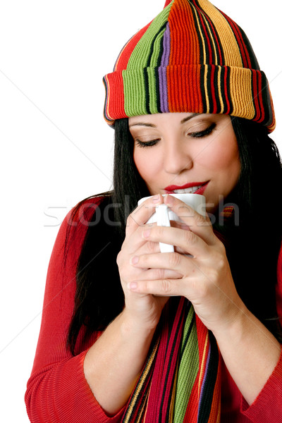 Stock photo: Woman drinking a hot drink