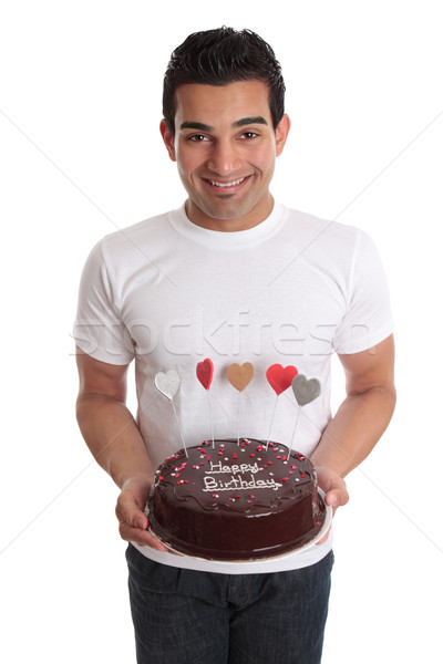 Man carrying chocolate cake decorated with hearts Stock photo © lovleah