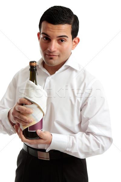 Pincér szolgáló tart üveg bor pezsgő Stock fotó © lovleah