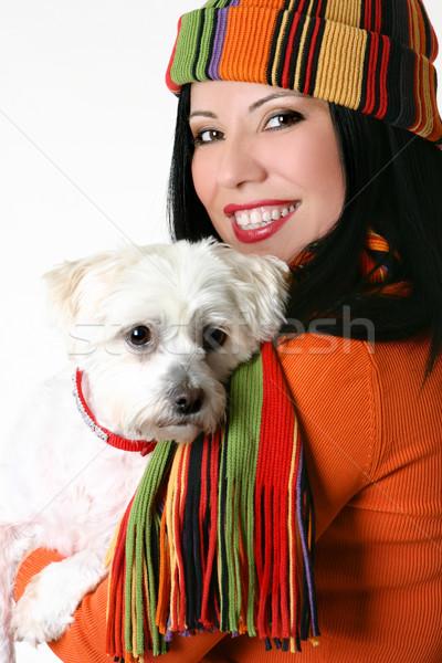 Female cuddling a pet dog Stock photo © lovleah