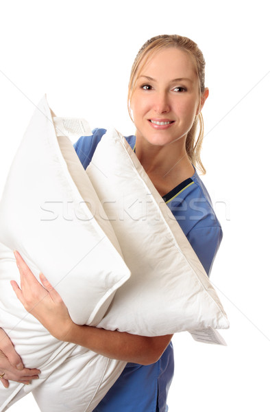 Healthcare worker carrying patient pillows Stock photo © lovleah