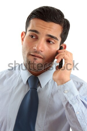 Businessman on mobile phone thinking Stock photo © lovleah