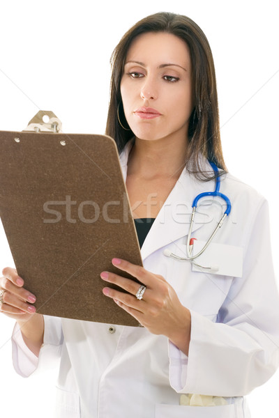 Doctor reading medical records Stock photo © lovleah