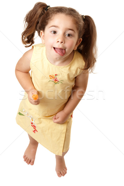 Adorable girl looking up and licking lips Stock photo © lovleah