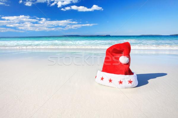 Christmas Santa hat on sunny beach in Australia Stock photo © lovleah