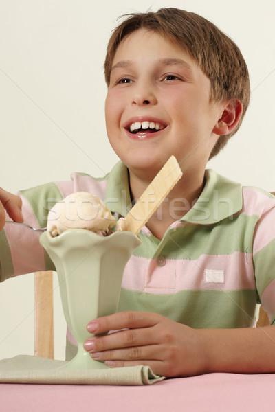 Mosolyog fiú fagylalt sundae vidám fiú gyermek Stock fotó © lovleah